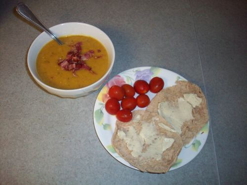 Yummy soup, served with grape tomatoes and an Arnold's sandwich thin topped with Laughing Cow cheese.
